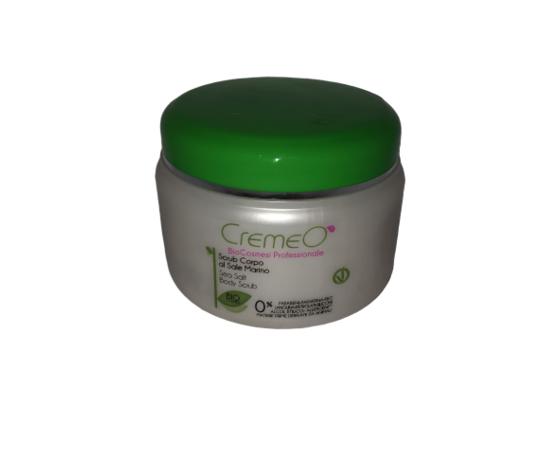Scrub Corpo al Sale Marino Bio CREMEO':    Lo Scrub corpo al sale marino è un prodotto esfoliante in grado di rimuovere dalla cute cellule morte ed impurità, regalando una pelle morbida, luminosa, levigata e idratata grazie all'azione del sale marino che rinnova l'epidermide attraverso una delicata azione esfoliante. Il Lipogel di cui è costituito ha proprietà emollienti e restitutive e svolge una spiccata azione preparatrice della pelle a ricevere i successivi trattamenti di bellezza, favorendo la penetrazione degli attivi nei tessuti e massimizzandone i risultati. Modo d'uso: massaggiare il prodotto in senso circolare sulla pelle umida per uno scrub delicato, e sulla pelle asciutta per un maggior effetto esfoliante. Risciacquare con acqua tiepida. Utilizzate regolarmente lo scrub una o due volte alla settimana. ml 500 INCI Componenti – Ingredients: Ethylhexyl palmitate, Maris sal, Glycine soja oil, Silica, Triticum vulgare germ oil, Simmondsia chinensis oil, Polyglyceryl-4 caprylate, Prunus amygdalus dulcis oil, Calendula officinalis extract, Helianthus annuus seed oil, Aqua, Sodium lauroyl glutamate, Decyl glucoside, Diglycerin, Potassium hydroxide, Tocopherol, Parfum.