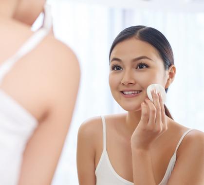 Woman washing face shutterstock 595168403