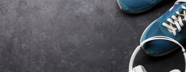 Fitness concept sneakers and headphones sdx78nj
