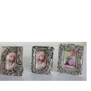 Gecas Regali dal mondo - Portafoto Polystone Argentato Misura 10x12 cm.