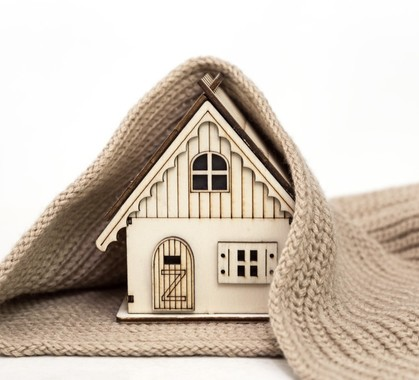 Toy wooden house wrapped in a warm knitted scarf on a white background business concept buy t20 pxaobj