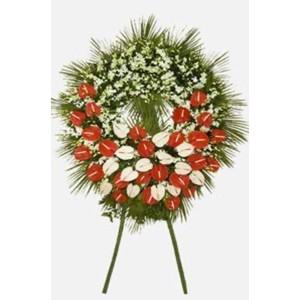 Corona funebre con rose e anturium