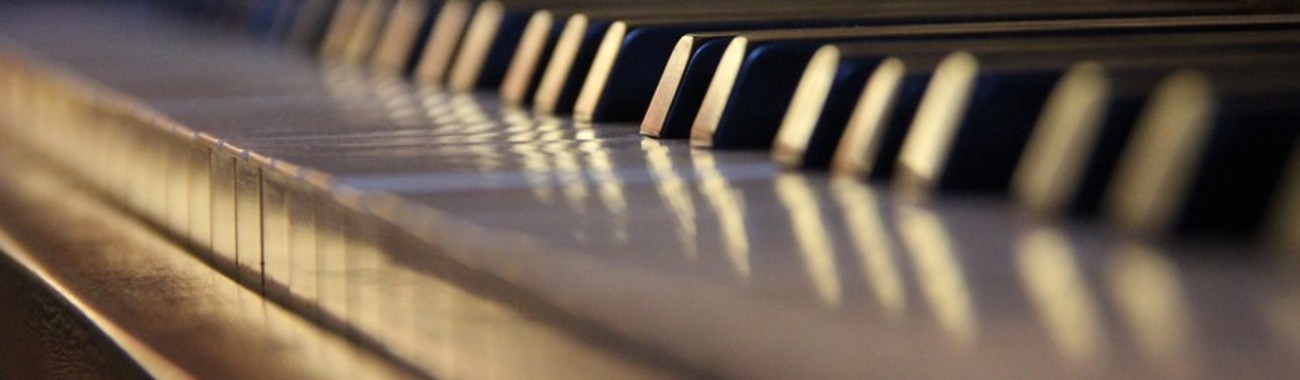 Piano closeup with the natural light reflected on the keys music natural light low angle keys depth t20 bk9obm