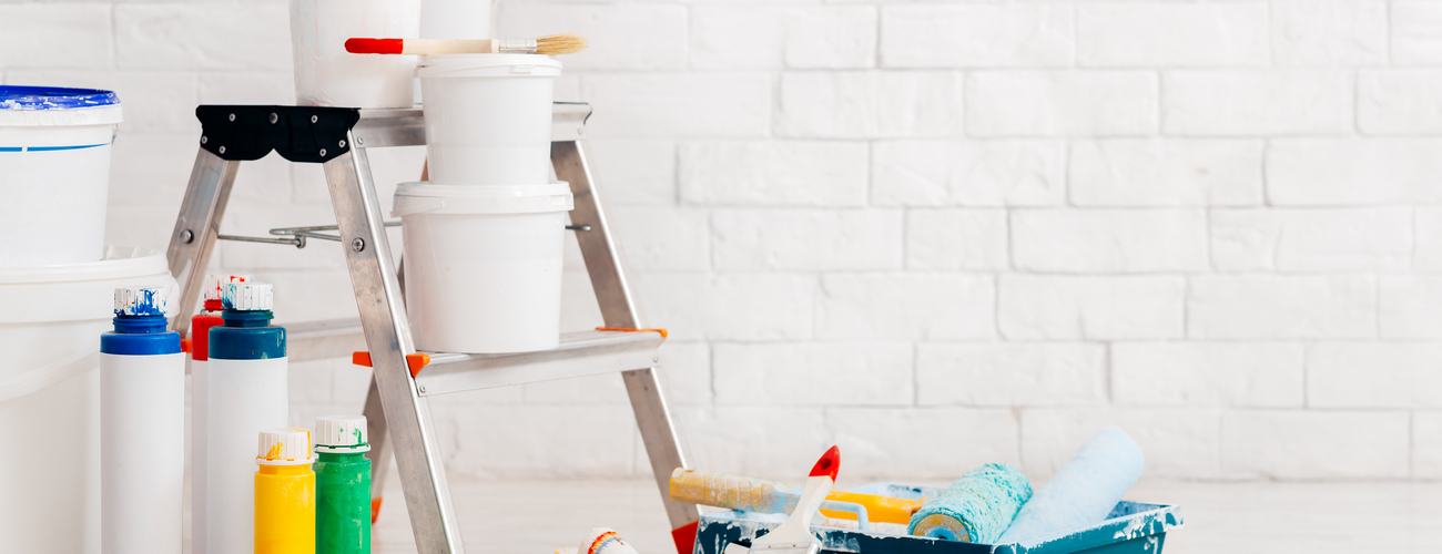 Painting supplies with ladder and paints against b x9j56j7