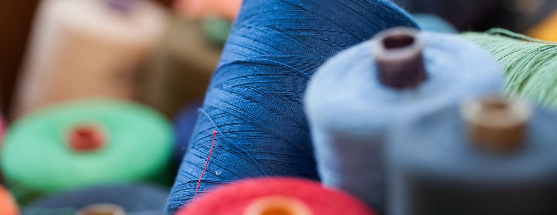 Closeup image of various colour threads