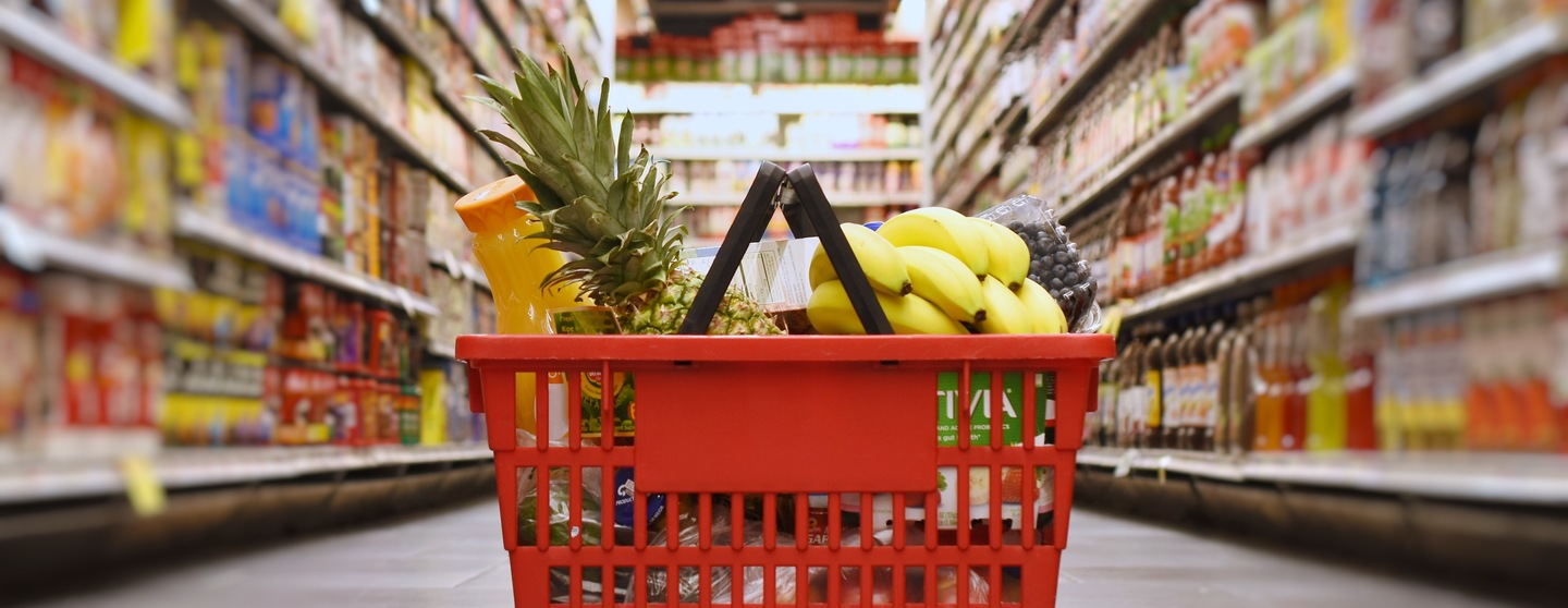 Basket with groceries in the supermarket lmtnrwg