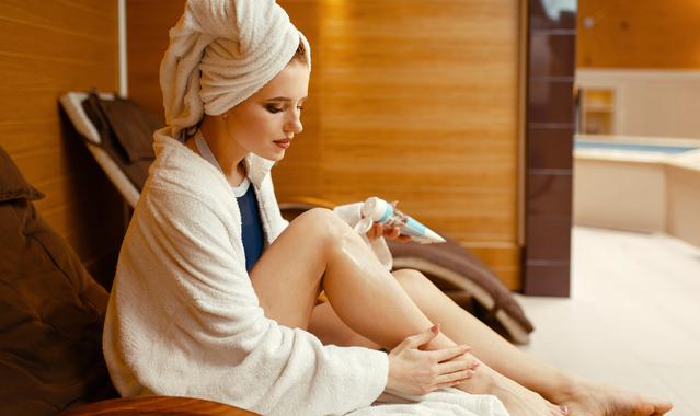 Sexy girl applying cream in spa chair body care bdsvtqu