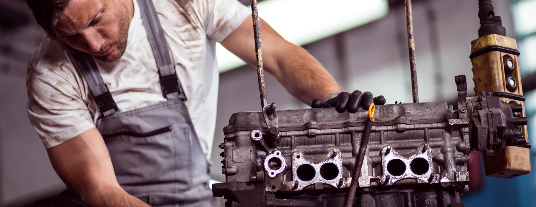Car engine hanging on hoist pj78pb2