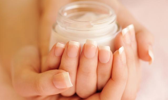 Beautiful woman hands with cream plmhjkt