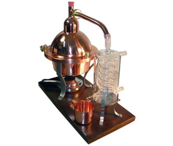 95652 10141f51028e37066100d17ba1e13032 alambicco distillatore in rame e vetro1